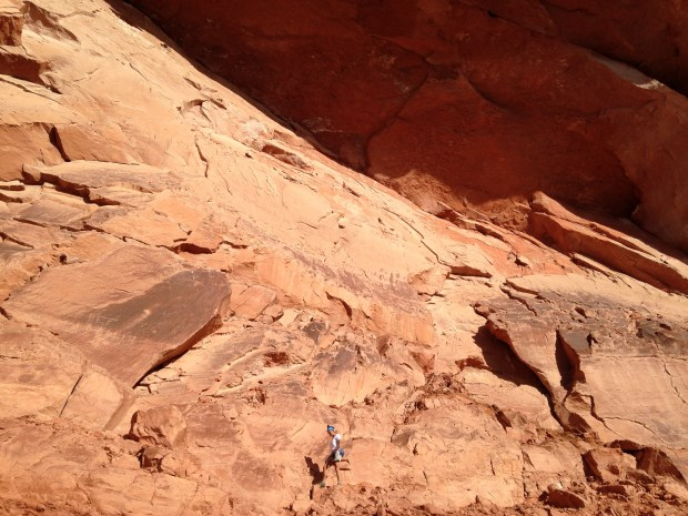 Walking under the arch, Red Cliffs National Conservation Area, Utah