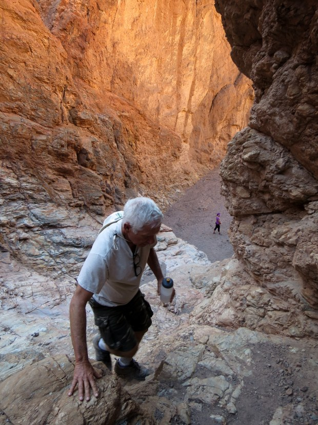 Tom climbing to top of dry falls, Natural Bridge Canyon, Death Valley National Park, California