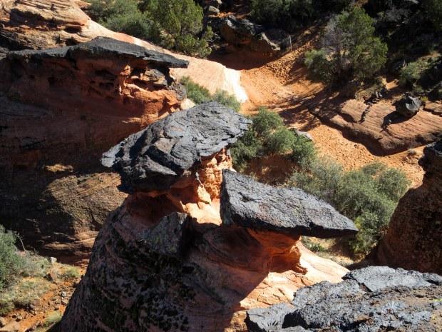 Black volcanic rock capping Navajo sandstone, Snow Canyon State Park, Utah
