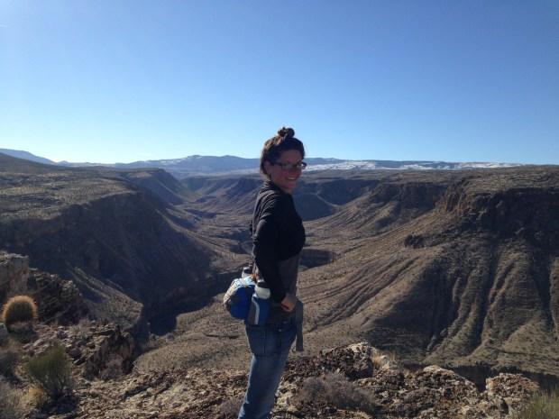 Me adjusting my pack at the rim of the canyon, Black Rock, Arizona