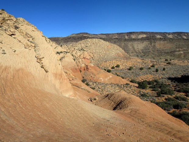 Exploring more checkerboard sandstone off the Yellow Knolls Trail, Red Cliffs Desert Reserve, Utah
