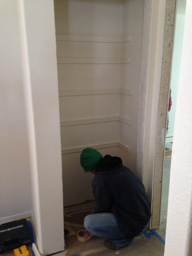 Me finishing installing pantry shelf brackets, Mesilla Valley Habitat for Humanity, Las Cruces, New Mexico
