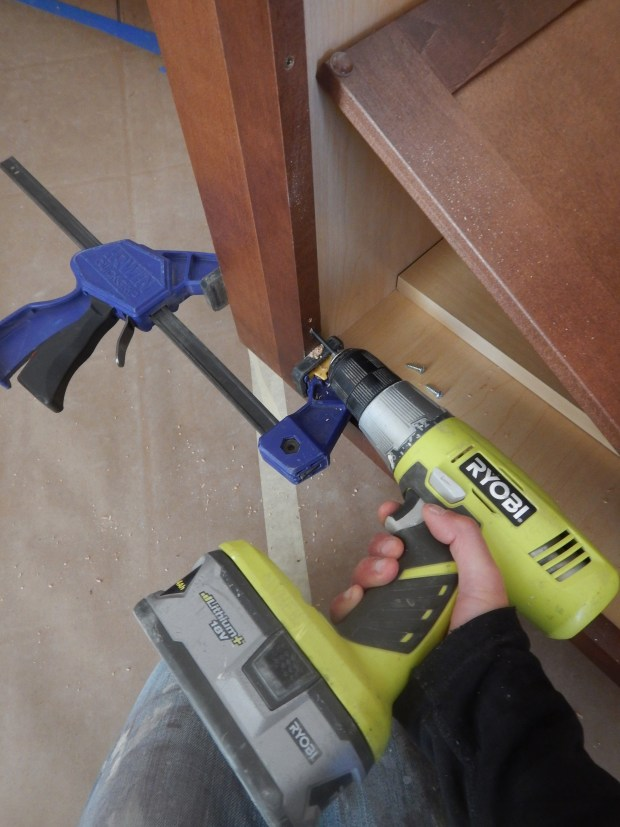 Me drilling holes to screw in spacers for kitchen cabinets, Mesilla Valley Habitat for Humanity, Las Cruces, New Mexico