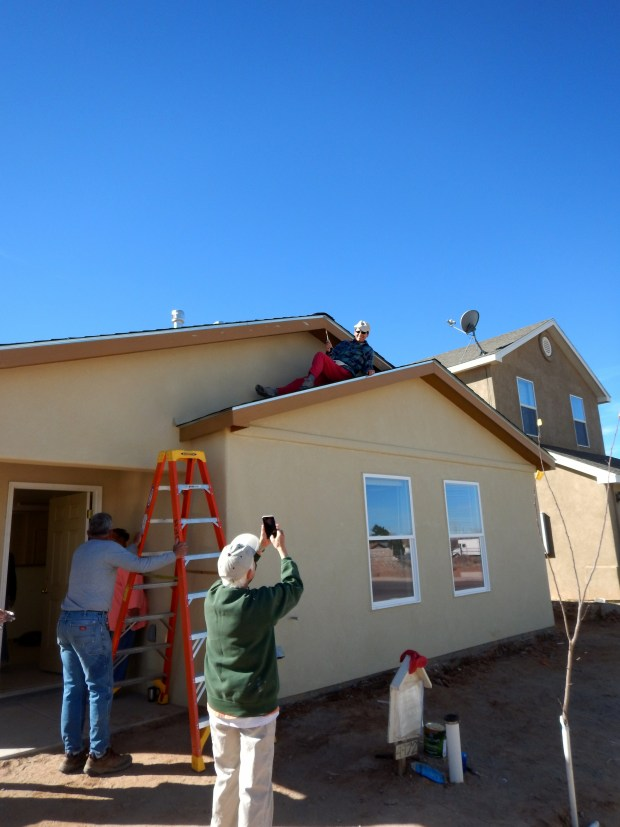 Impromptu photo shoot of Deborah posing while painting trim, Mesilla Valley Habitat for Humanity, Las Cruces, New Mexico