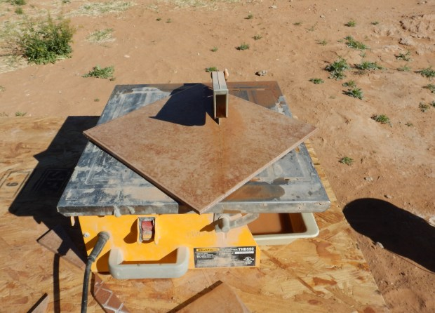 Wet-sawing tile, Mesilla Valley Habitat for Humanity, Las Cruces, New Mexico