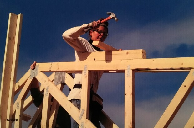 Me nailing bracing between the first and second trusses. My expression is 1 part determination and 2 parts fear of standing up there.