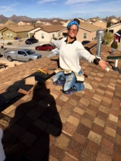 Me posing while hammering down the hip and ridge shingles over the ridge vent