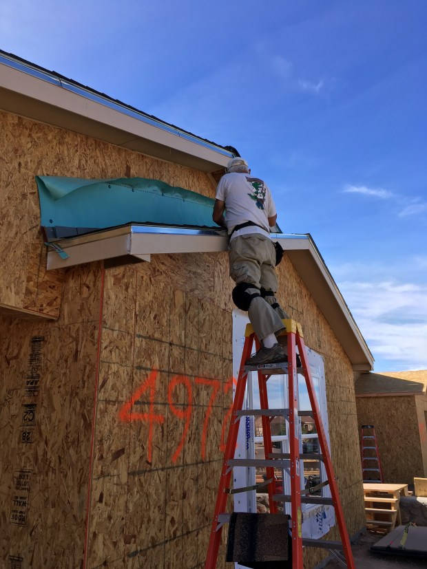 Tom shingling the front gable