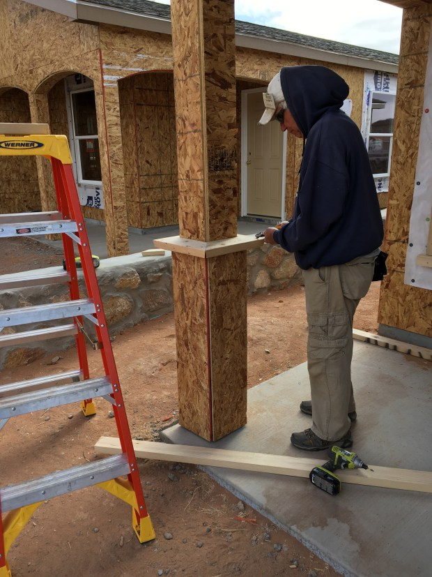 Tom adding porch column accoutrements to Cindy's house