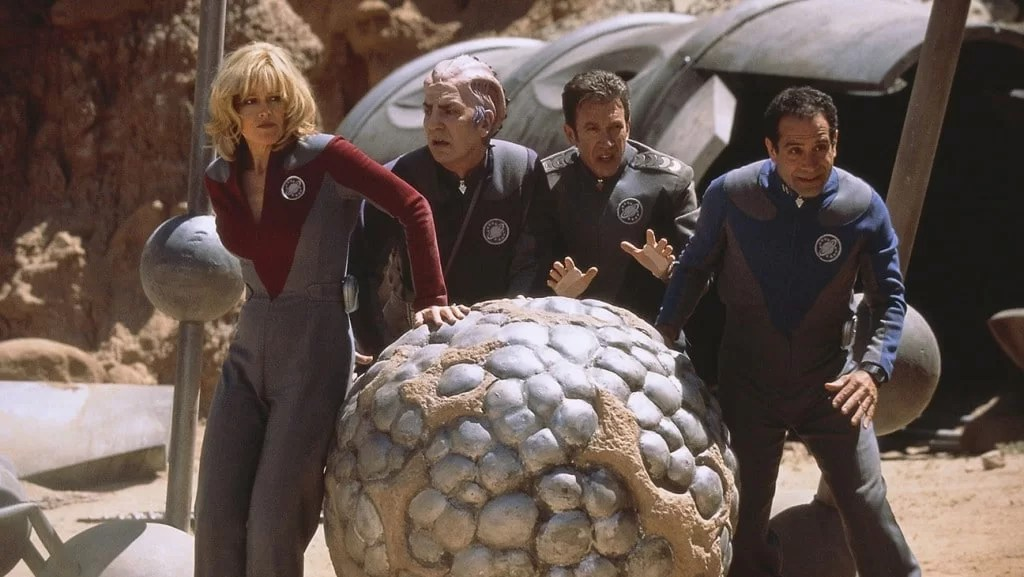 Galaxy Quest (1999) Directed by Dean Parisot Shown from left: Sigourney Weaver (as Gwen DeMarco/Lt. Tawny Madison), Alan Rickman (as Alexander Dane/Dr. Lazarus), Tim Allen (as Jason Nesmith/Cmdr. Peter Quincy Taggart), Tony Shalhoub (as Fred Kwan/Tech Sgt. Chen)