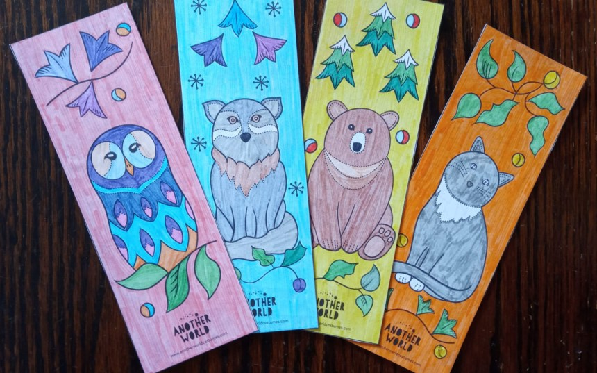 Set of four printable animal bookmarks which are coloured in and displayed in a fan shape.