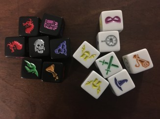 White dice for party members, and black dice for monsters.