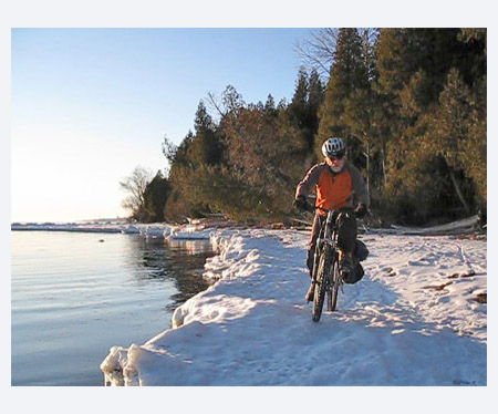 Biking frozen shore of Lake Ontario