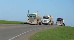 Tractor-trailers hauling oil and water on North Dakota highway.