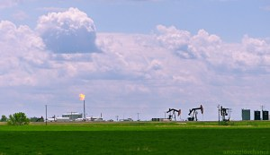 Oil well in southeast Saskatchewan, with flared gas.
