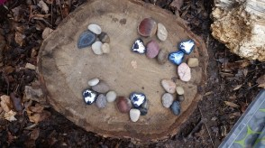 Grouping pebbles by fives to count