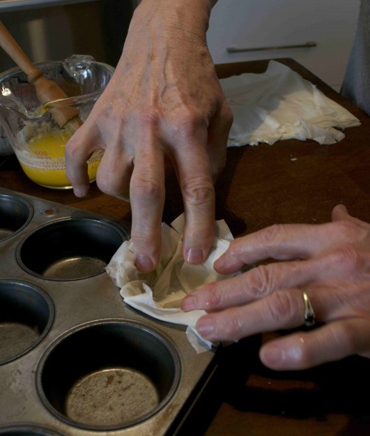 phyllo cups for dessert pressing dough into pan