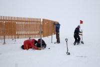 (Left to Right) Scott Landolt, carpenter Elizabeth Mockbee, carpenter Rachel Biggs and Carol Constanza install a Double Fence Intercomparison Reference