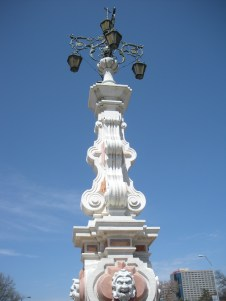 Seville Light Exact replicas as found in Suville, Spain. Theatrical faces at the base are fountains. Notice the intricate iron detail of the lamp. 1967.