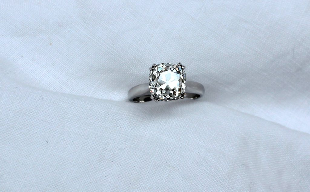 A solitaire diamond ring, the old cushion cut stone measuring 10mm x 9mm x 7mm deep, approximately 4.2 carats, claw set in a platinum mount and shank. Sold for £9,000 at Anthemion Auctions