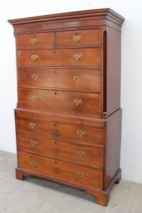 A George III mahogany chest on chest, the moulded cornice above two short and three long drawers, the base with a brushing slide above four long drawers on bracket feet, 118.5cm wide x 55.5cm deep x 188cm high. Sold for £900 at Anthemion Auctions