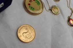 A 1974 gold Krugerrand, together with a silver proof coin, and assorted costume jewellery, cased goblets etc. Sold for £830 at Anthemion Auctions