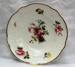 A Nantgarw porcelain bowl, with a gilt line decorated rim, a moulded border, painted with sprays of garden flowers and a butterfly, the centre painted with a spray of garden flowers. Sold for £1,050 at Anthemion Auctions