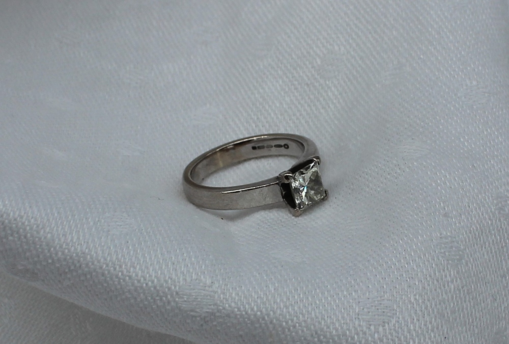 A solitaire diamond ring, the princess cut stone measuring approximately 5.25mm x 5.25mm, estimated at approximately 0.75 of a carat, to an 18ct white gold claw setting and shank. Sold for £1,000 at Anthemion Auctions