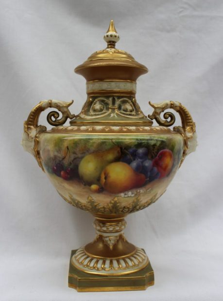A Royal Worcester twin handled vase and cover, hand painted with apples, pears, cherries and grapes. Sold for £820 at Anthemion Auctions
