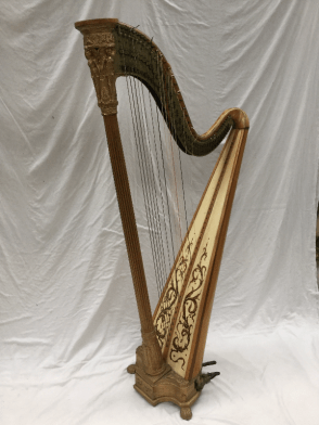 satin birch and giltwood Grecian harp by J. A. Stumpff, with winged figures above a fluted stem, the brass frame stamped `PATENT HARP INVENTED BY J. A. Stumpff, LONDON, No. 44 Great Portland St. Portland Place`, and 'maker TO HIS MAJESTY KING OF GREAT BRITAIN`, with forty three string and seven foot pedals (eighth pedal missing), with four shell feet , 172cm high. Sold for £780 at Anthemion Auctions