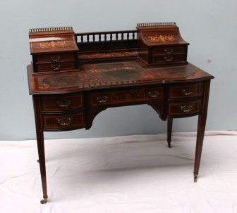 An Edwardian rosewood Carlton house desk. Sold for £550 at Anthemion Auctions