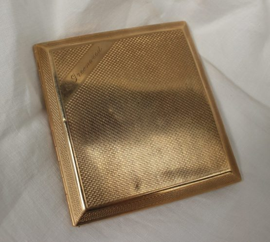 "A 9ct yellow gold cigarette case with engine turned decoration inscribed ""E Greenwood"". Sold for £680 at Anthemion Auctions"