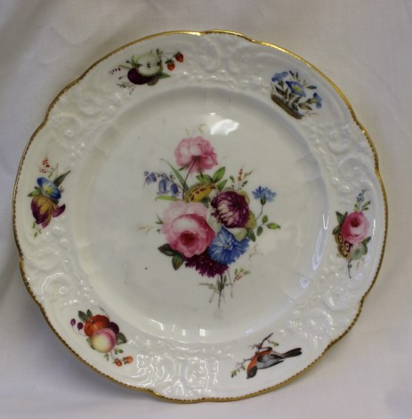 A Nantgarw porcelain plate decorated with birds and sprays of garden flowers to a moulded and gilt highlighted rim, impressed mark NANT-GARW C W, 21.5cm diameter. Sold for £550 at Anthemion Auctions