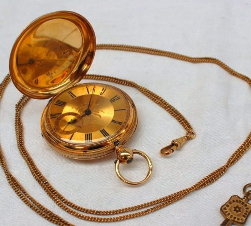 A Victorian 18ct yellow gold hunter pocket watch, with an engine turned outer case. Sold for £620 at Anthemion Auctions
