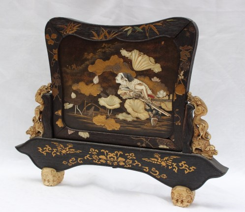 A Japanese shibayama lacquer and hardwood table screen inlaid and mounted with ivory and mother of pearl. Sold for £780 at Anthemion Auctions