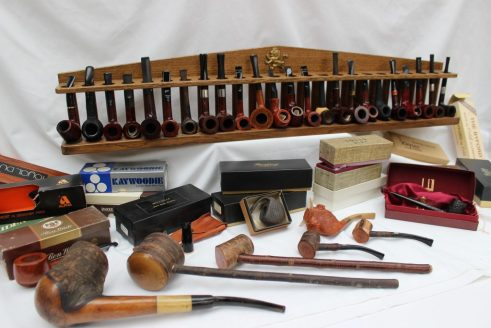 A collection of new pipes including Dunhill, Barling, Millville, Hardcastle, Ben Wade etc. Sold for £680 at Anthemion Auctions