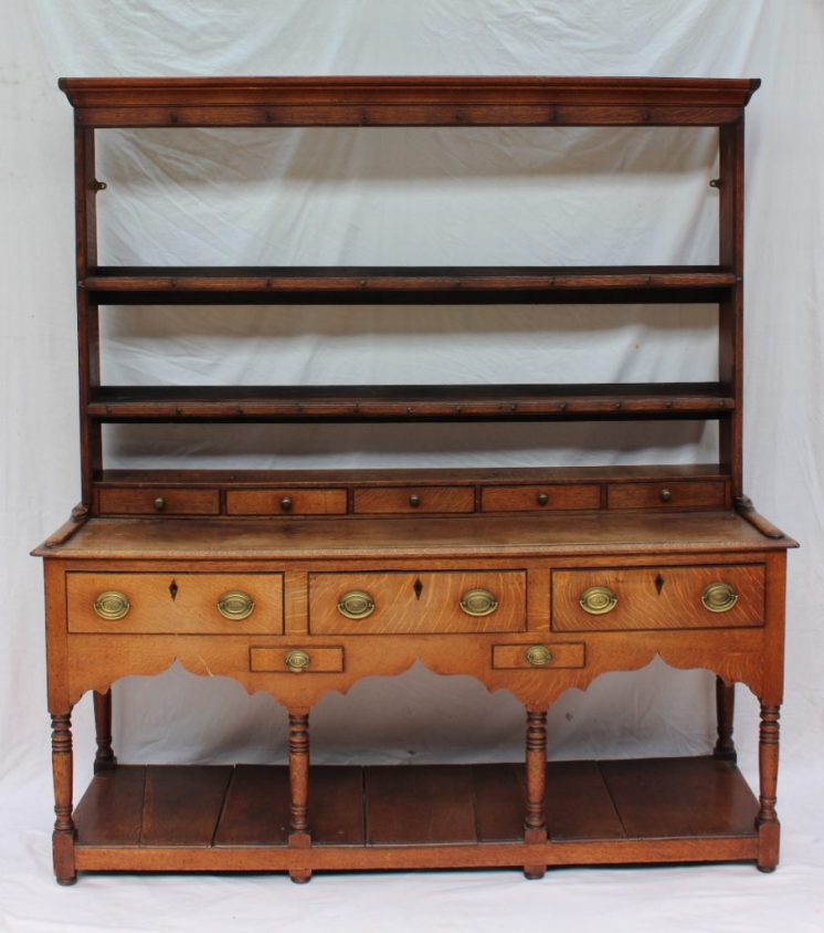 An 18th century South Wales oak dresser, the rack with a moulded cornice and two shelves. Sold for £750 at Anthemion Auctions