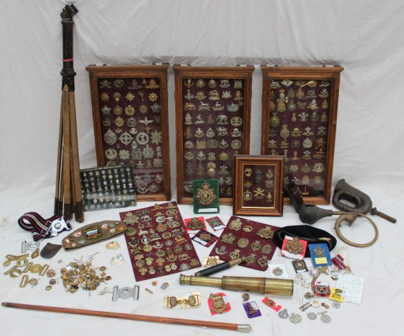 A large quantity of military cap and uniform badges . Sold for £1,450 at Anthemion Auctions