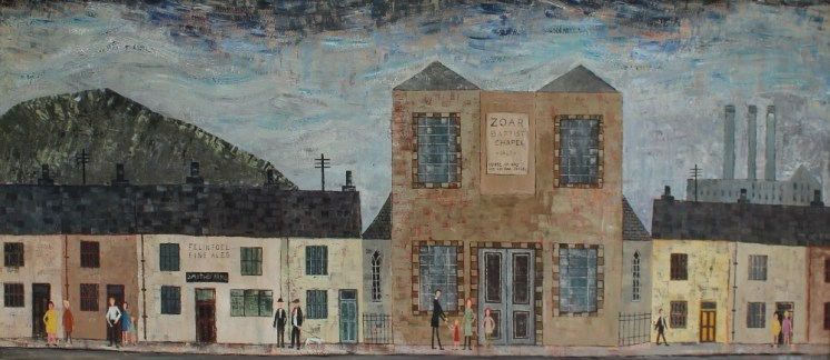 """Jack Jones - """"A Welsh Street"""" Depicting a Zoar Baptist chapel and figures on the pavement, Oil on board. Sold for £2,450 at Anthemion Auctions"""