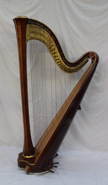A modern Russian Cecilia 46 string harp, by Lunacharsky, St Petersburg with seven pedals, hexagonal waisted column and gilt highlights, with a Clive Morley Harps label, 181cm high. Sold for £1,300 at Anthemion Auctions