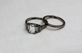 A stepped diamond ring with approx 1ct baguette diamond with baguette cut shoulders, with a platinum wedding band. Sold for £2,800 at Anthemion Auctions