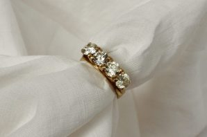 A four stone diamond ring set with round old cut diamonds. Sold for £850 at Anthemion Auctions