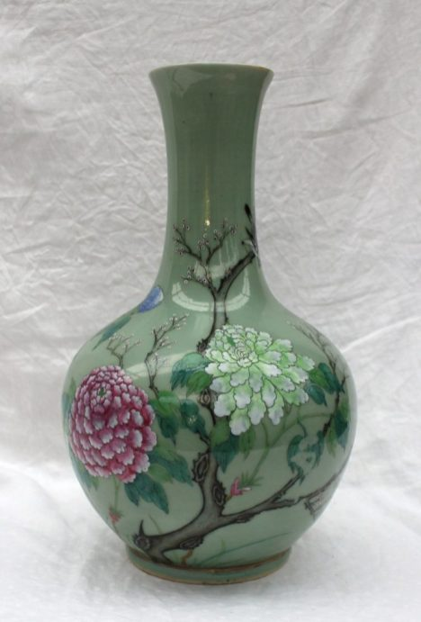 A large Chinese celadon vase with raised floral decoration in pinks, blues and greens, six character Qianlong mark to the base 39.5cm high . Sold for £1,550 at Anthemion Auctions