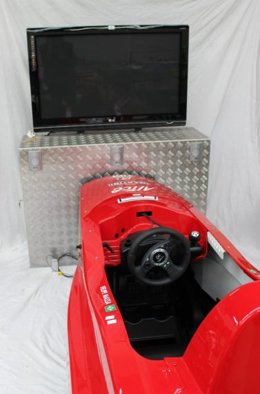 """An LG 42"""" flat screen television, mounted with a surround sound system, playstation and model racing car seat. Sold for £350 at Anthemion Auctions"""