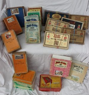 A collection of nineteen boxed jig-saw puzzles including G.W.R. Henley Bridge, Kind George V, The Torbay Express, etc. Sold for £300 at Anthemion Auction