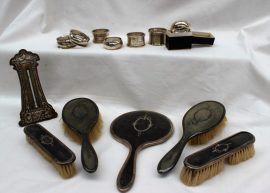 An Edward VII silver thermometer, Birmingham, 1904, together with a silver and tortoiseshell part dressing table set, napkin rings etc. Sold for £90 at Anthemion Auctions