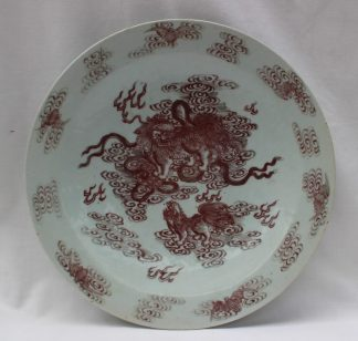 A Chinese porcelain plate painted with bats to the border and dogs of foo to the centre, 26.5cm diameter. Sold for £1,250 at Anthemion Auctions