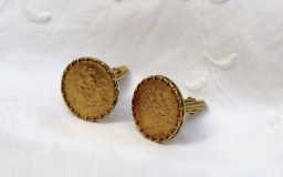 Two George V gold half sovereigns dated 1914 and 1916 mounted in a 9ct cufflink mount. Sold for £300 at Anthemion Auctions