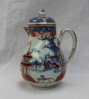 A Chinese porcelain sparrow beak lidded jug, underglaze blue decoration of buildings and trees, overpainted in iron red with figures and pagodas, 12cm high. Sold for £85 at Anthemion Auctions