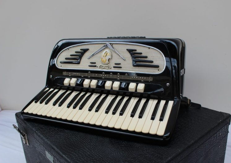 Lot 443 - Sold for £430 - A Galanti Piano accordion, with black lacquer finish, cased